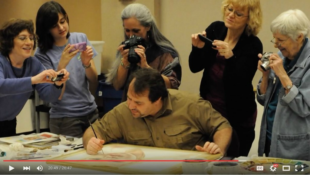 screenshot from the KMOS video, photo of Paul at one of his workshops